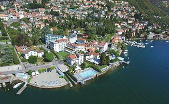 Grand Hotel Imperiale Lake Como aerial shot hotel building pool on the edge of Lake Como