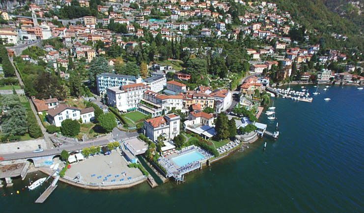 Grand Hotel Imperiale Lake Como aerial shot hotel building pool on the edge of Lake Como