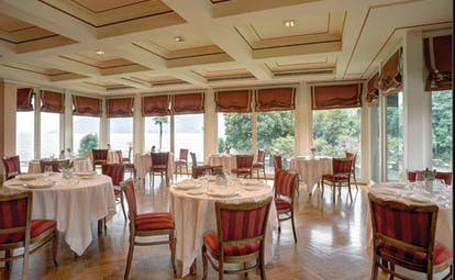 Grand Hotel Majestic Lake Maggiore restaurant indoor dining area traditional décor windows overlooking lake