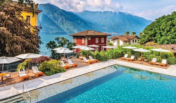 Grand Hotel Tremezzo Lake Como pool sun loungers umbrellas lake in background