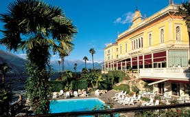 Grand Hotel Villa Serbelloni Lake Como exterior shot hotel and pool mountains and lake in the background