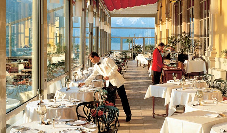 Grand Hotel Villa Serbelloni Lake Como restaurant indoor dining windows with views of the lake waiters