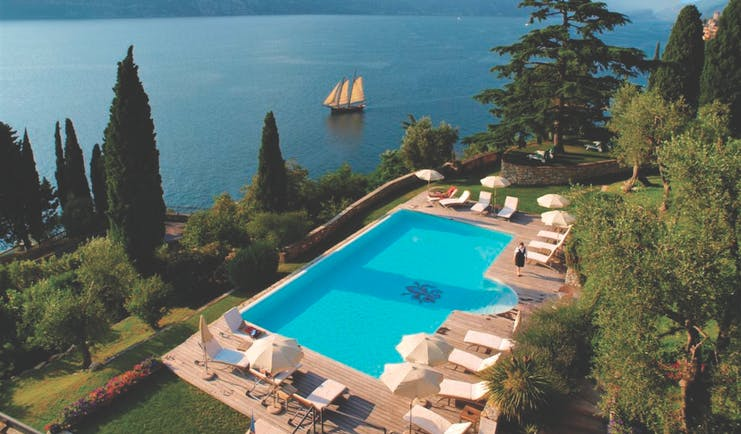 Bellevue San Lorenzo Lake Garda aerial shot of pool sun loungers view of lake