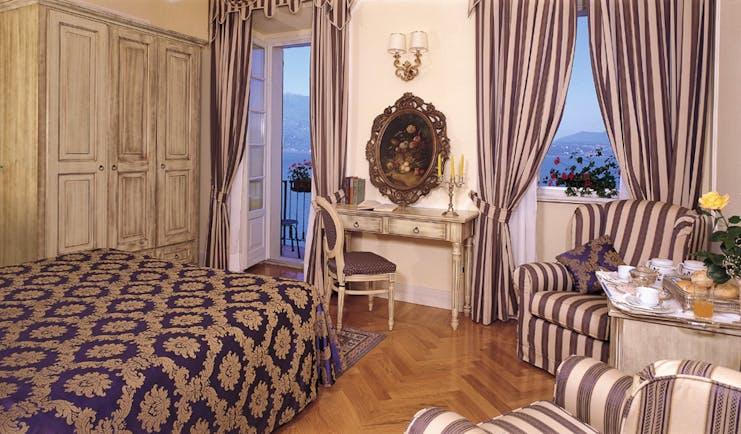 Hotel Cannero Lake Maggiore junior suite interior bed desk armchairs ornate décor