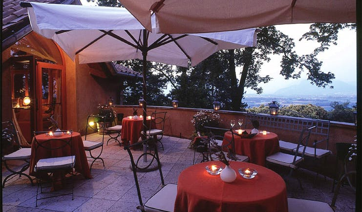 Hotel L'Albereta Lake Iseo dining terrace tables chairs overlooking lake