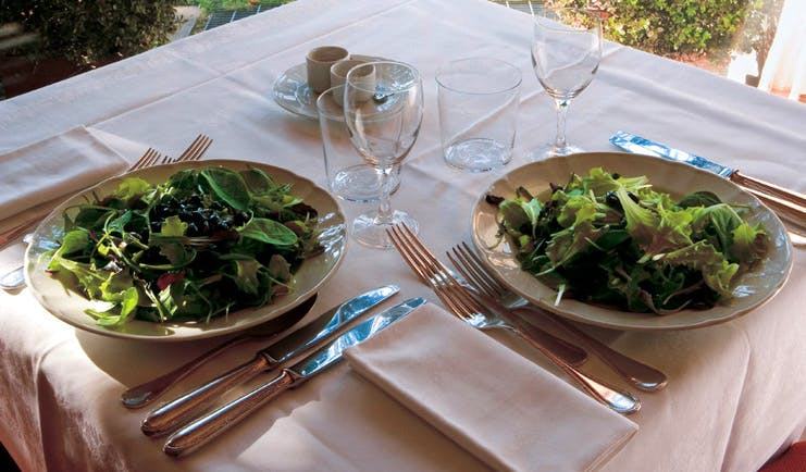 Hotel L'Albereta Lake Iseo dining table set for two large plates of fresh sala
