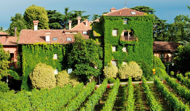 Hotel L'Albereta Lake Iseo facade exterior hotel building covered in vines