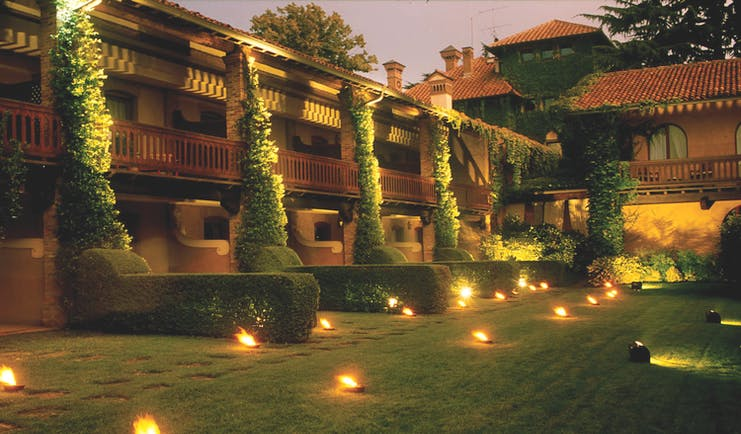 Hotel L'Albereta Lake Iseo gardens at night hotel exterior