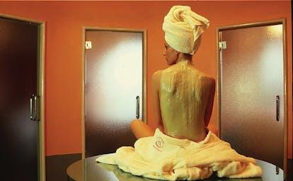 Hotel L'Albereta Lake Iseo mud treatment woman receiving spa treatment