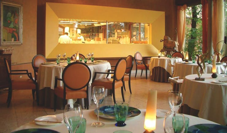 Hotel L'Albereta Lake Iseo restaurant indoor dining windows to kitchen contemporary décor