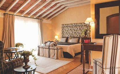 Hotel L'Albereta Lake Iseo superior suite contemporary décor bed armchair large windows