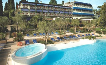 Hotel Olivi Lake Garda exterior hotel and pool sun loungers trees