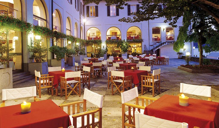 Hotel San Rocco Lake Orta terrace dining patio tables chairs trees
