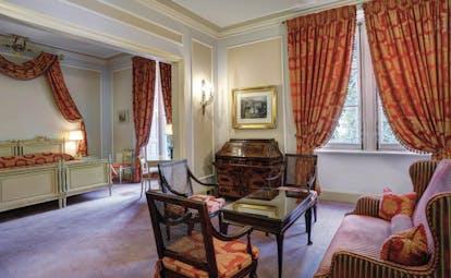 Villa d' Este Lake Como junior suite bedroom and lounge area traditional décor