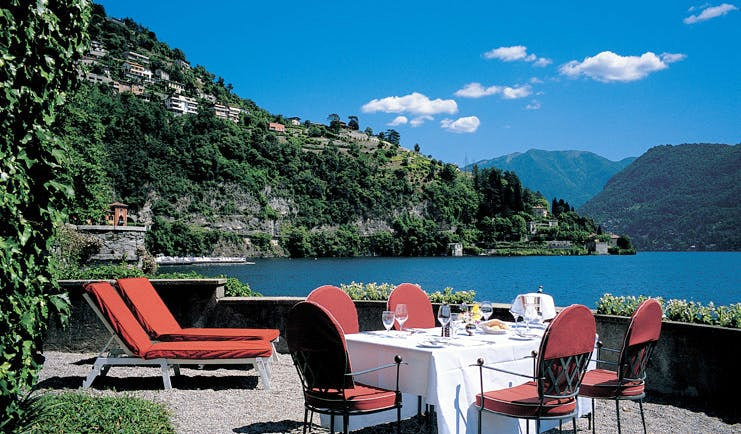 Villa d' Este Lake Como terrace sun loungers outdoor dining view of lake and surrounds