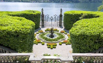 aerial view of fountain and iron gates at villa carlotta on lake como