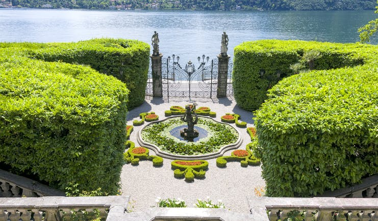 aerial view of fountain and iron gates at villa carlotta on lake como