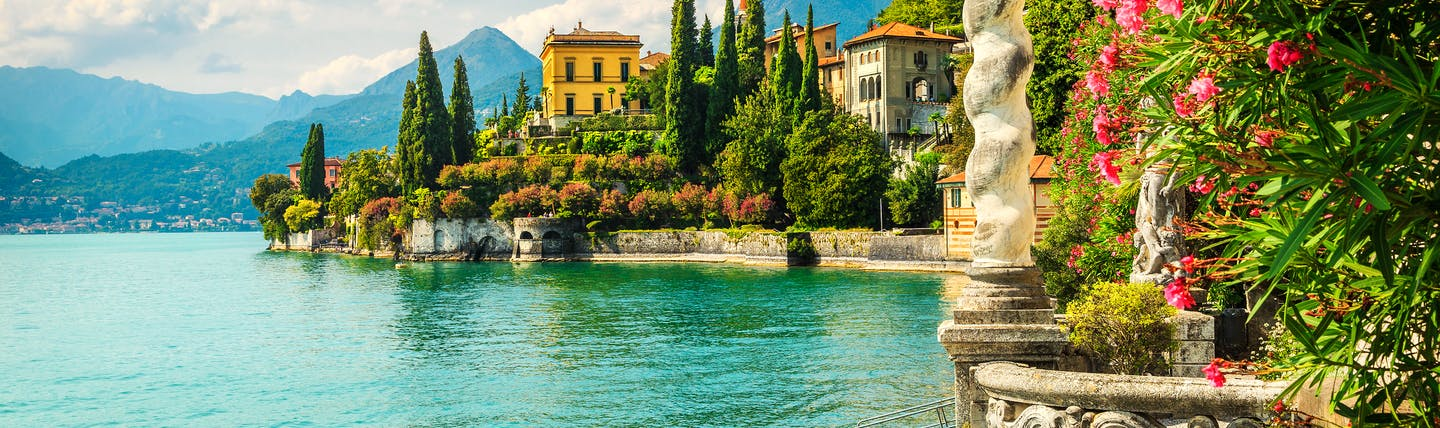 Blue waters of Lake Como with the balcony and garden frontage of the Villa Monastero