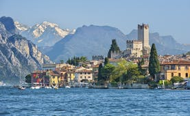 Village of Malcesine on the shore of blue Lake Garda with mountains behind