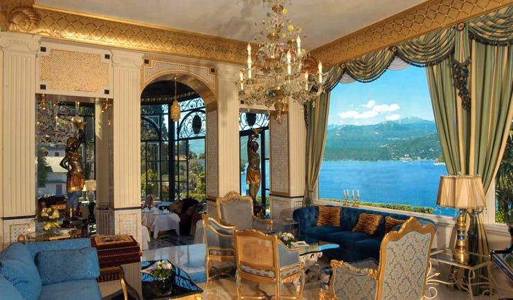 Villa Aminta Lake Maggiore lounge communal seating area ornate décor lake views
