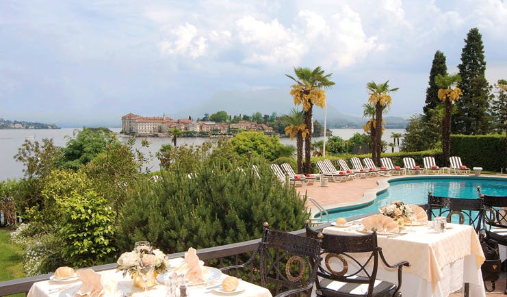 Villa Aminta Lake Maggiore poolside terrace tables chairs lake views