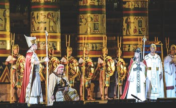 Aida act one men on stage in long white and gold robes