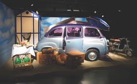 Small blue car in museum
