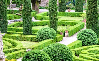 Symmettical gardens of box and cypress with statues in Verona