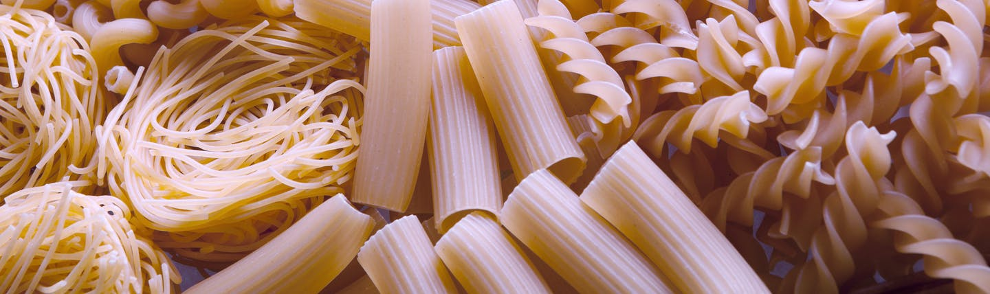 Heap of dry pasta in different shapes