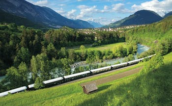 Orient Express train in Austrian mountain landscape