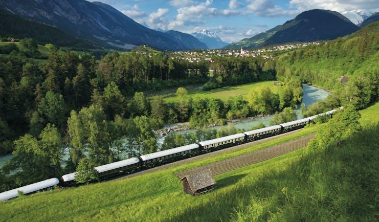 Orient Express train in Austrian mountain landscape