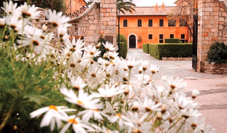 La Posta Vecchia Latium gateway leading to hotel flowers