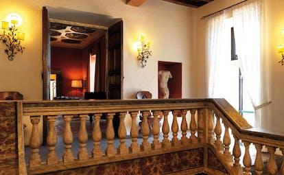 La Posta Vecchia Latium hall way antiques ornate décor