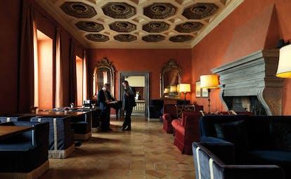 La Posta Vecchia Latium lounge communal seating area ornate décor original architecture