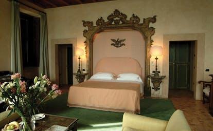 La Posta Vecchia Latium senior suite bedroom bed armchairs ornate décor