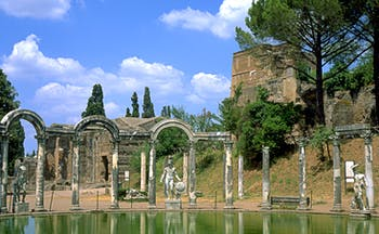 Roman columns and stone arches around pool at Hadrian's Villa in Tivoli near Rome