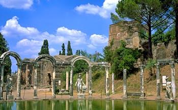 Roman columns and stone arches around pool at Hadrian's Villa in Tivoli near Rome