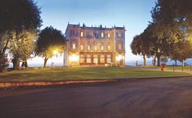 Vila Grazioli Latium hotel exterior at sunset lawns trees