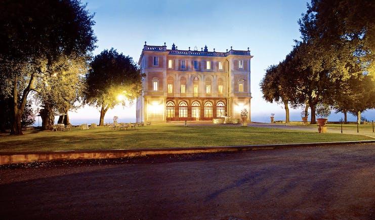 Vila Grazioli Latium hotel exterior at sunset lawns trees