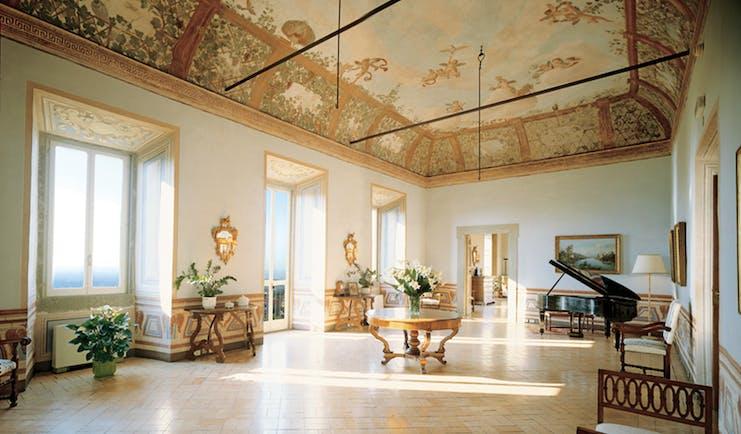 Vila Grazioli Latium Sala Dei Putti grand piano large windows frescoed ceiling ornate décor