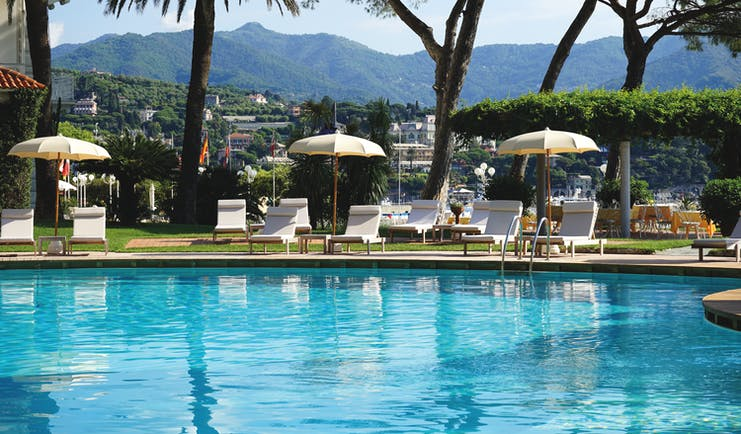 Grand Hotel Miramare Ligurian Riviera pool sun loungers umbrellas mountains in the distance