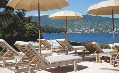 Grand Hotel Miramare Ligurian Riviera view from pool sun loungers umbrellas overlooking the sea