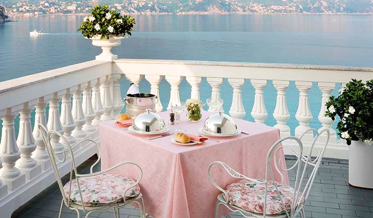 Grand Hotel Miramare Ligurian Riviera suite terrace outdoor dining views over the sea coastline in the distance