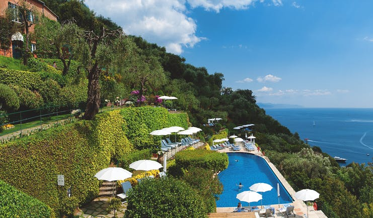 Splendido Portofino pool sun loungers umbrellas overooking the sea views of the bay