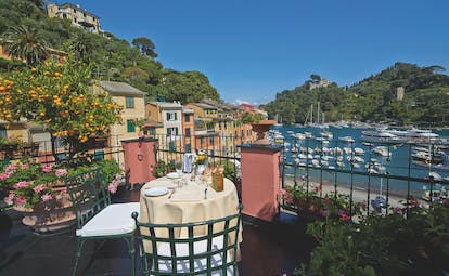 Splendido Portofino Ava Gardner suite terrace outdoor dining overlooking boats in the harbour