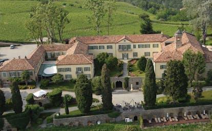 Relais San Maurizio Piemonte aerial shot of hotel buildings gardens pool