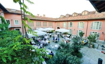 Relais Villa D' Amelia Piemonte courtyard outdoor dining trees
