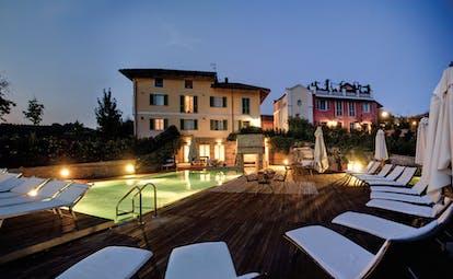 Relais Villa D' Amelia Piemonte pool lit up at night sun loungers