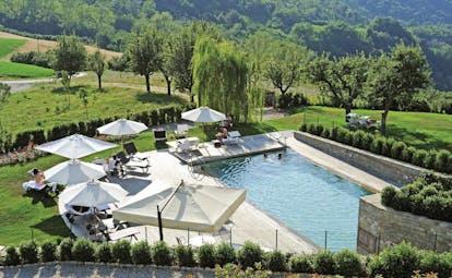 Relais Villa D' Amelia Piemonte pool sun loungers view of countryside