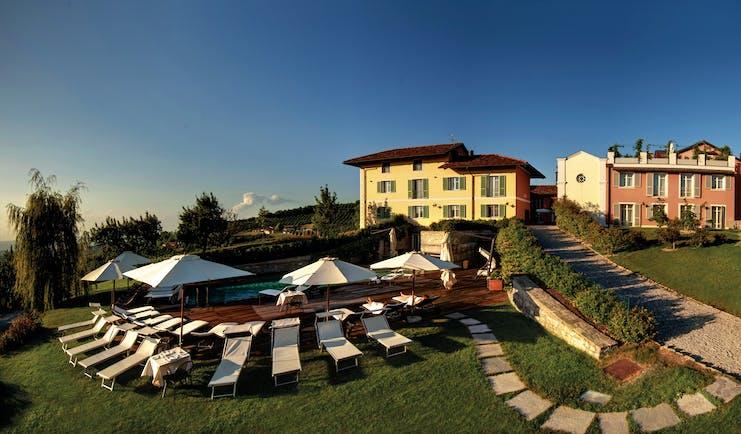Relais Villa D' Amelia Piemonte pool side sun loungers hotel building rear